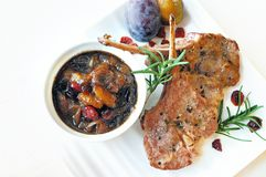 Lamb Chops with Prune Chutney. Rosemary lamb chops with prune, shallot and cranberry chutney Royalty Free Stock Image