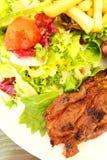 Lamb chops with salad & fries Royalty Free Stock Image
