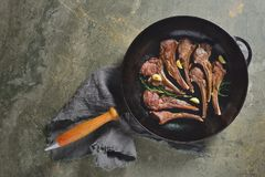 Lamb chops sauteed in a cast iron pan Stock Photography