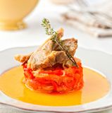 Lamb chops sophisticated dish. Lamb chops served with bell pepper and onion Royalty Free Stock Photo