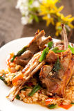 Lamb Chops with spicy rice. And vegetables Royalty Free Stock Photo