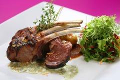 Lamb chops tandoori style. And Colombian potatoes rosemary stock image