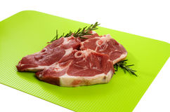 Lamb Chump Chops. Raw Lamb Chump Chops on green chopping board Stock Photo