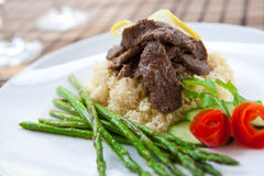 Lamb with cous cous and asparagus for meal Royalty Free Stock Image