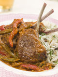 Lamb Cutlet Jalfrezi with Fragrant Pilau. And Indian Beer Royalty Free Stock Image