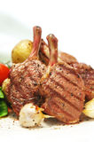 Lamb Cutlets. With roasted potatoes and garlic.  Closeup view Stock Photo