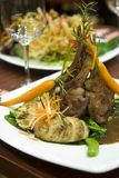 Lamb Cutlets. Topped with a rosemary jus and set on potato Stock Image