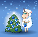 Lamb decorates a Christmas tree Royalty Free Stock Photography