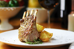 Lamb Dinner. Rack of lamb with seeded mustard, rosemary and roasted potatoes Stock Images