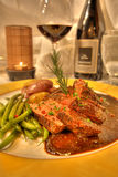 Lamb entree dinner with wine in a fine dining restaurant Royalty Free Stock Photography
