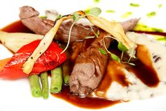 Lamb filet. Slightly smoked lamb filet with puree and wine sauce with vegetables royalty free stock images