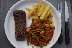 Lamb filet with garlic potatoes royalty free stock photography