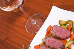 Lamb filet and a glass of wine Royalty Free Stock Photo