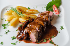 Lamb filet with noodles and sauce stock images