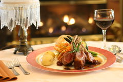 Lamb by Fireplace. Rack of Lamb in a Restaurant Royalty Free Stock Images