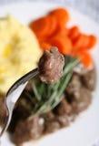 Lamb on fork Stock Photos