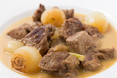 Lamb fricassee with onion macro Stock Photo