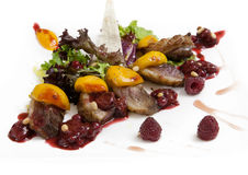 Lamb with fruit and berry sauce Royalty Free Stock Images