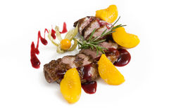 Lamb with fruit and berry sauce Royalty Free Stock Photo