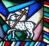 The lamb of God. Stained glass church window Stock Photography