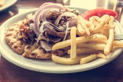 Lamb gyros with onion of fries. Stock Images