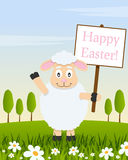 Lamb with Happy Easter Sign in a Meadow Stock Photo