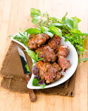 Lamb with herbs. Roast lamb with herbs on a white plate Stock Photos