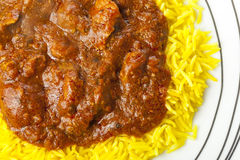 Lamb jalfrezi curry and pilau rice on a plate Royalty Free Stock Images