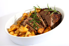 Lamb joint and roast potatoes Stock Photo