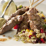 Lamb kebab. And quinoa with vegetables (corn, bell pepper Stock Images