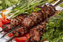 Lamb kebab. Grilled Lamb on skewers with vegetable Stock Images