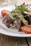 Lamb kebab with thyme and tomato Royalty Free Stock Photo