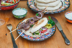 Lamb kebab on a traditional greek plate Stock Photography