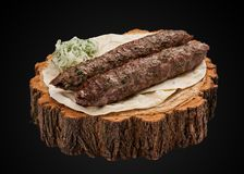 Lamb Kebab on a wooden slice stock photo
