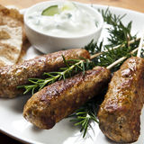Lamb Kofta. Served with cucumber yogurt and flat bread Royalty Free Stock Photo