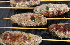 Lamb Kofta on a grill plate Royalty Free Stock Photography