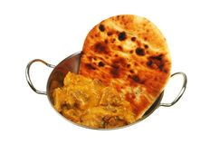 Lamb korma. And naan bread in a balti dish Stock Images
