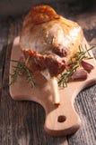 Lamb leg on board Stock Images