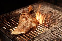 Lamb leg on charcoal grill Stock Photography