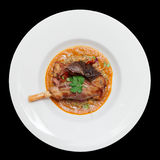 Lamb leg with lentils isolated on black Stock Image