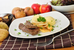 Lamb liver with apple and onion rings Stock Image