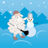 Lamb making a snowman Royalty Free Stock Images