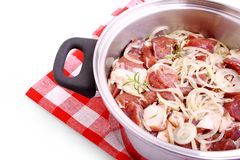 Lamb marinated with onion, spices and herbs in cooking pot Stock Photo