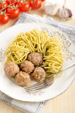 Lamb meat balls with green pesto spaghetti Royalty Free Stock Images