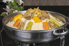 Lamb meat on couscous at an oriental restaurant Stock Image