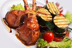 Lamb meat with garnish. Close up stock image