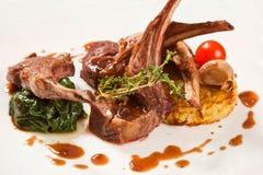 Lamb meat with garnish Stock Photos