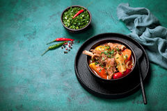 Lamb meat stewed Khashlama with potatoes, carrots, pepper and spices Stock Photos