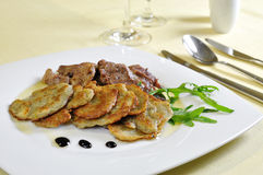 Lamb medallions with homemade. Potato pancakes, czech cuisine Royalty Free Stock Photography