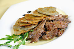 Lamb medallions with homemade. Potato pancakes, Czech cuisine Stock Photos